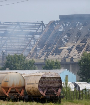 Smoke rises after an explosion at a grain silo that injured several people on the site of the company Silostra, located on the Rhine River port, in Strasbourg