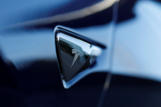 The logo on 2018 Tesla Model 3 electric vehicle is shown in Cardiff, California