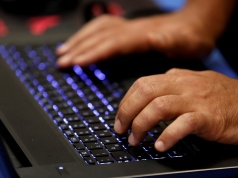 A man types into a keyboard during the Def Con hacker convention in Las Vegas