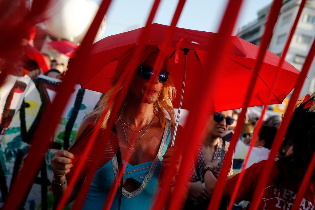 A drag queen takes part in a gay pride parade in Athens