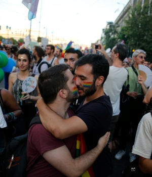 Two men kiss during a Gay Pride parade in Athens