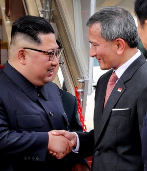 Singapore's Foreign Minister Vivian Balakrishnan welcomes North Korean leader Kim Jong Un on his arrival in Singapore