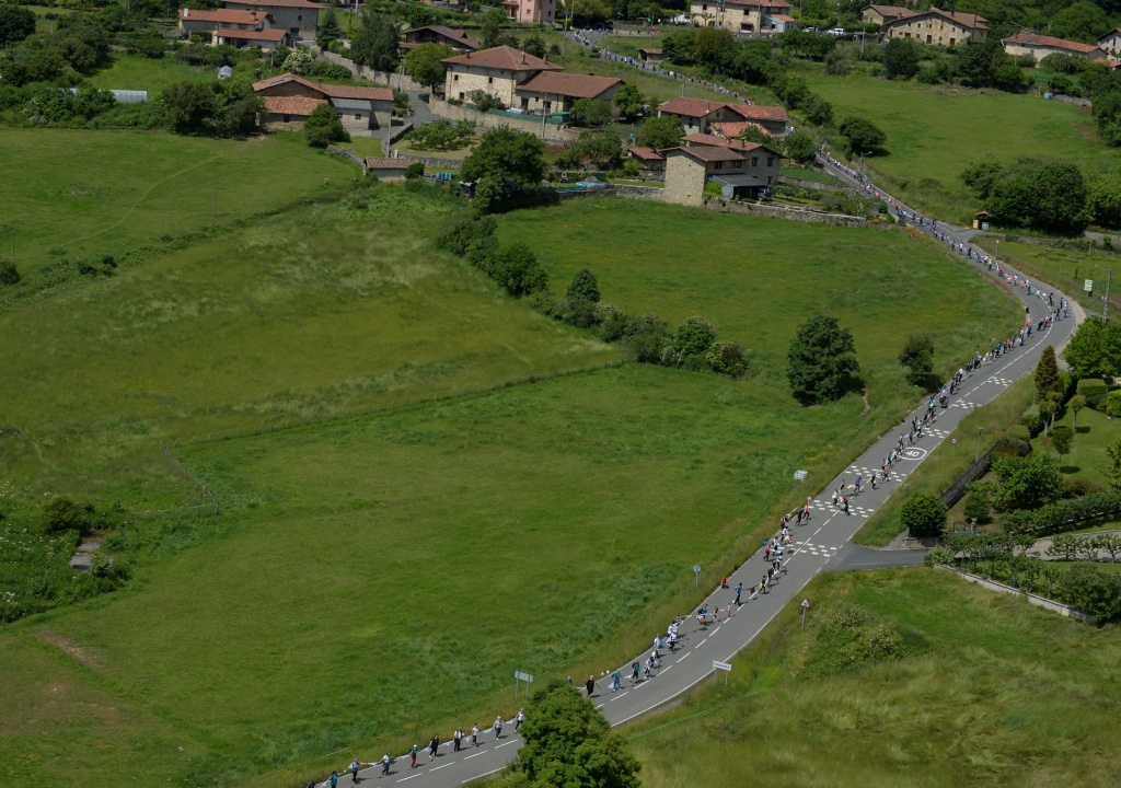 People join hands to form a 202 km (125 miles) human chain calling for a right to vote on Basque independence