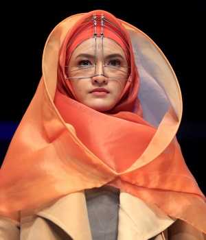 A model presents creations by student designer Sherly Az Zahra on the first day of the Indonesia Muslim Fashion Festival in Jakarta