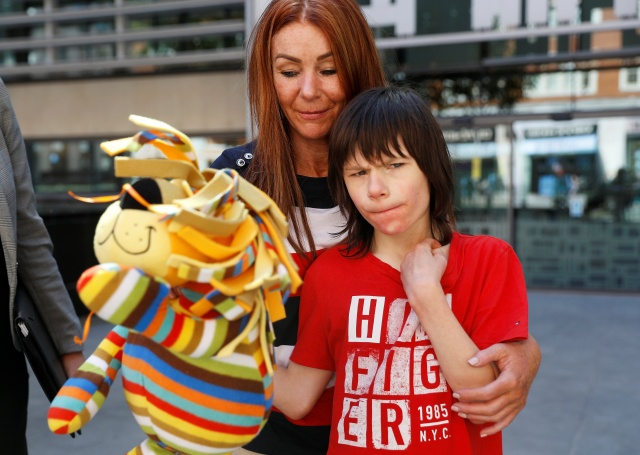 Charlotte Caldwell, and her son Billy, stand outside the Home Office during a break in a meeting with officials to discuss how Billy can have his severe epilepsy treated with cannabis oil, which is a banned substance in Britain, in London