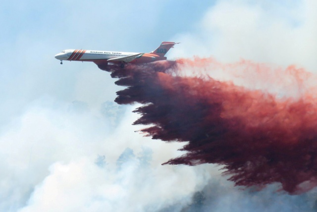 Plane drops fire-retardant chemicals on the 416 Fire near Durango, Colorado