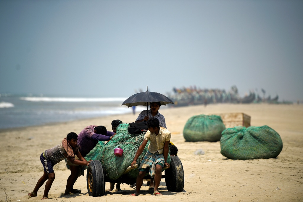 The Wider Image: Rohingya refugees fish in troubled waters