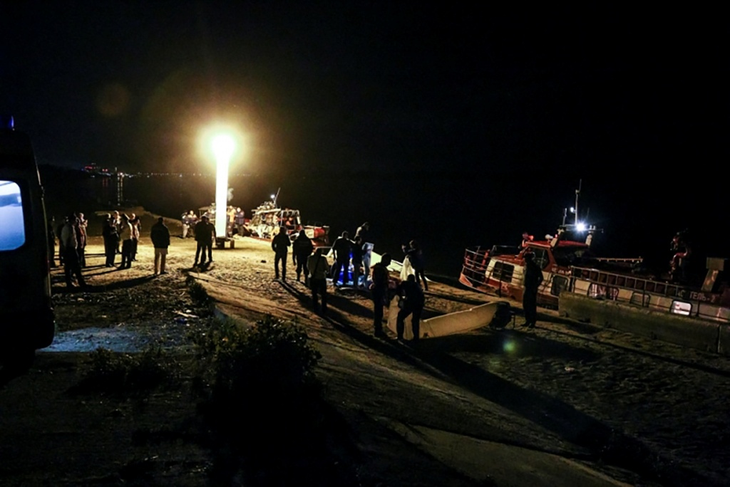 A view shows members of rescue services and investigators after a collision of a river cruise with a tugboat in Volgograd
