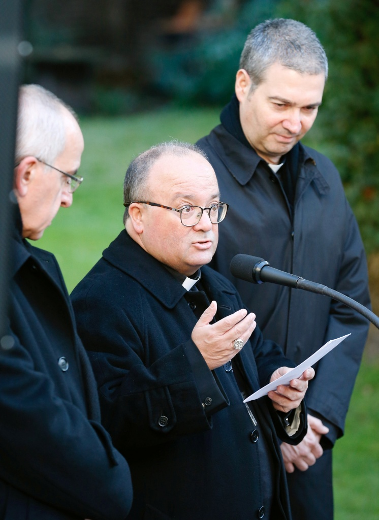 Archbishop Charles Scicluna and father Jordi Bertomeu, Special Vatican envoys, and apostolic nuncio in Chile Ivo Scapolo deliver a news conference in Santiago