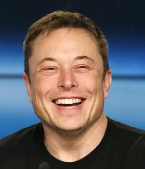 SpaceX founder Musk smiles at a press conference following the first launch of a SpaceX Falcon Heavy rocket in Cape Canaveral
