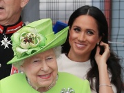 Britain's Queen Elizabeth and Meghan, the Duchess of Sussex, arrive in Runcorn