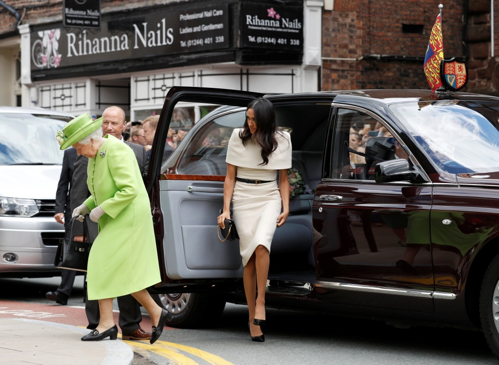 Britain's Queen Elizabeth and Meghan, the Duchess of Sussex, arrive at the Storyhouse during their visit to Chester