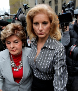 Zervos, a former contestant on The Apprentice, leaves New York State Supreme Court with attorney Allred in Manhattan, New York