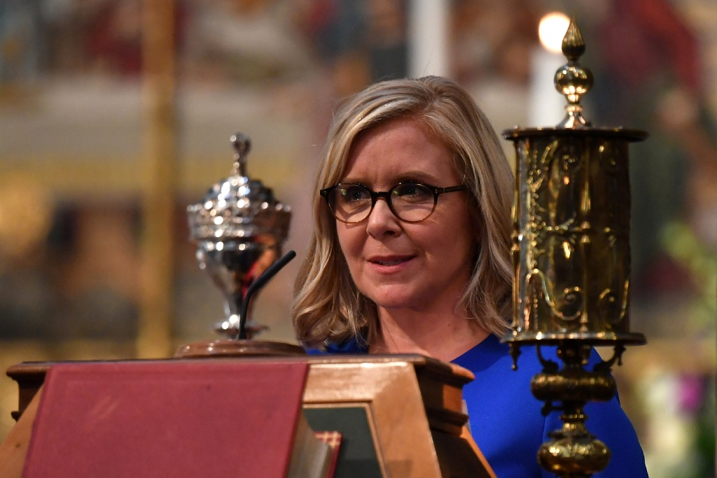 Lucy Hawking, daughter of Stephen Hawking, speaks at a memorial service for British scientist Stephen Hawking during which his ashes will be buried in the nave of the Abbey church, at Westminster Abbey, in London