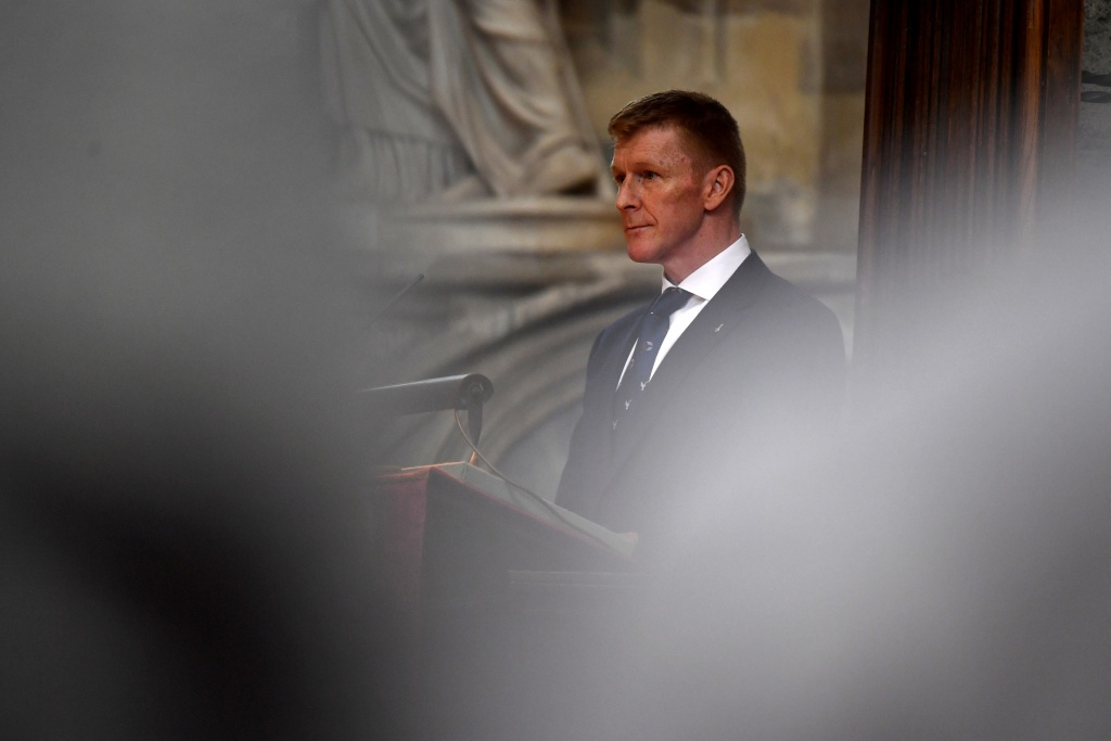 British astronaut Tim Peake speaks at a memorial service for British scientist Stephen Hawking during which his ashes will be buried in the nave of the Abbey church, at Westminster Abbey, in London