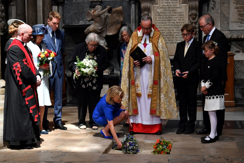 Dean of Westminster John Hall presides over the interment of the ashes of British scientist Stephen Hawking during a memorial service at Westminster Abbey in London