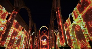 People attend the Lisbon Under Stars spectacle performed at Carmo's Ruins in Lisbon