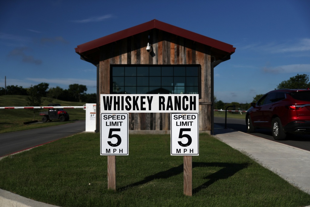 Signs are seen at entrance to Firestone & Robertson Whiskey Ranch in Forth Worth, Texas