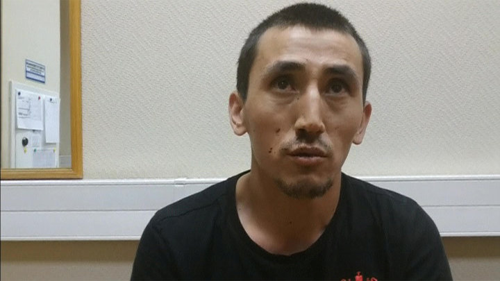 Anarbek Chingiz, taxi driver who ploughed into crowd on June 16 in central Moscow, is questioned by police in Moscow