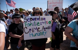 People participate in a protest against a recent U.S. immigration policy of separating children from their families when they enter the United States as undocumented immigrants, outside the Tornillo Tranist Center, in Tornillo