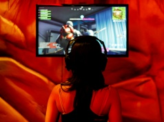An attendee plays a video game at E3, the world's largest video game industry convention in Los Angeles