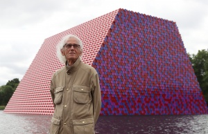 Artist Christo stands in front of his work The London Mastaba, on the Serpentine in Hyde Park, London