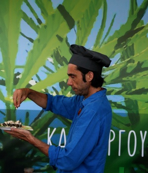 A man prepares a cannabis-based plate during the Balkannabis Expo 2018, in Athens