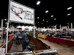 Dealers tend their booths during the Guntoberfest gun show in Oaks, Pennsylvania