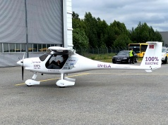 A two-seat electric plane made by Slovenian firm Pipistrel stands outside a hangar before a test flight at Oslo Airport