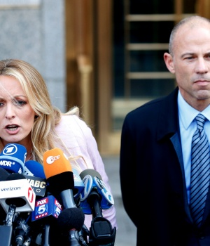 Adult film actress Stephanie Clifford, also known as Stormy Daniels, speaks to media along with lawyer Michael Avenatti outside federal court in Manhattan