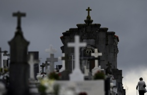 A woman walks along tombs at the municipal cemetery of San Salvador in Oviedo
