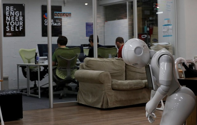 SoftBank's humanoid robots 'Pepper' is seen as students attend Code Chrysalis, a software-coding boot camp, at a basement room in Tokyo