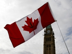 A Canadian flag with a marijuana leaf on it is seen during the annual 4/20 marijuana rally on Parliament Hill in Ottawa