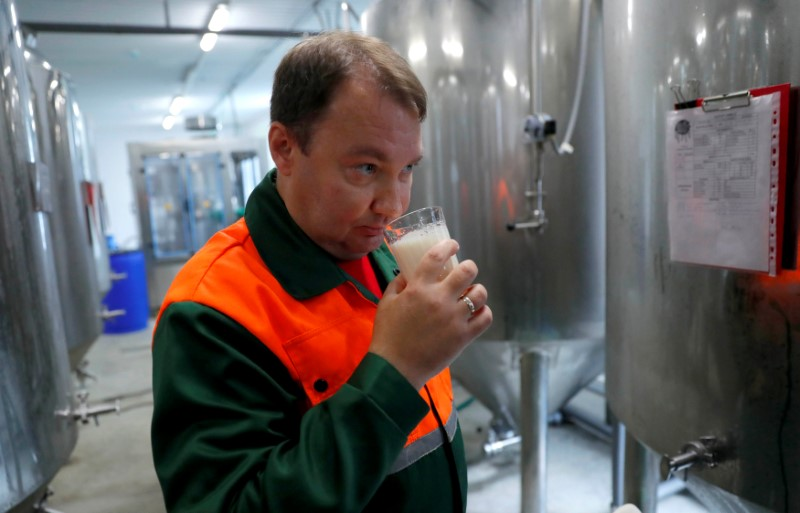 Chief brewer Alexei Saburov samples beer at the Melody Brew brewery in Polevskoy