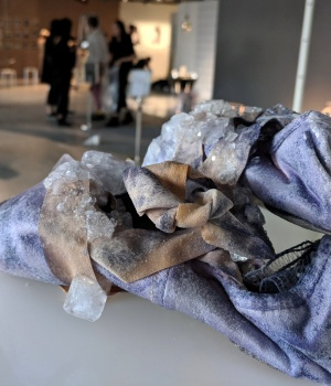 Urine crystals grow on a pair of ballet shoes, as part of a collection by Alice Potts that imagines a future where accessories are grown from our bodily excretions, in the Royal College of Art Fashion Show in London