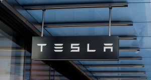A sign is seen outside Tesla Motors' new showroom in Manhattan's Meatpacking District in New York City