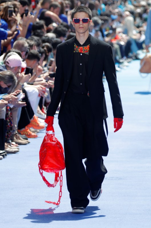 A model presents a creation by designer Virgil Abloh as part of his Spring/Summer 2019 collection for Louis Vuitton fashion house during Men's Fashion Week in Paris