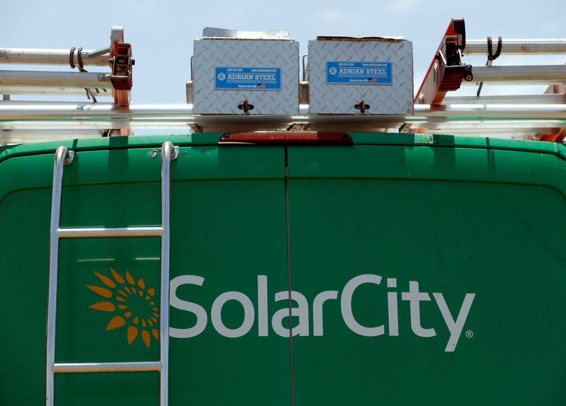A SolarCity vehicle is seen on the road in San Diego, California