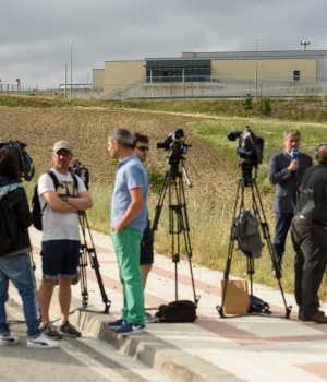 Journalists wait outside the prison where three of the five men cleared of gang rape of a teenager and convicted of a lesser crime of sexual abuse are due to leave jail after being granted provisional release in Pamplona