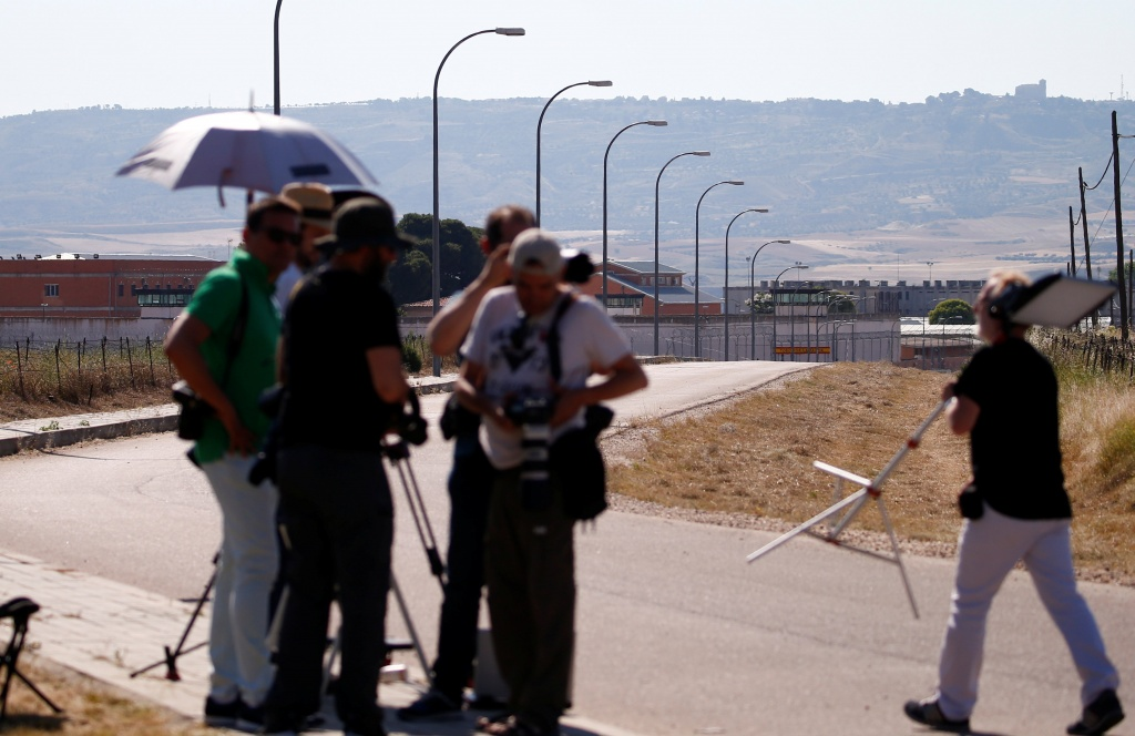 Journalists wait outside the prison where two of the five men cleared of gang rape of a teenager and convicted of a lesser crime of sexual abuse are due to leave jail after being granted provisional release in Alcala de Henares