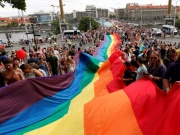Participants hold a giant rainbow flag during the Prague Pride Parade where thousands marched through the city centre in support of gay rights, in Czech Republic