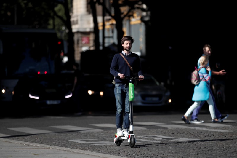 Lime's France director Arthur-Louis Jacquier rides a dock-free electric scooter Lime-S by California-based bicycle sharing service Lime on their launch day in Paris
