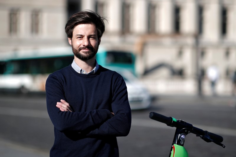 Lime's France director Arthur-Louis Jacquier poses near a dock-free electric scooter Lime-S by California-based bicycle sharing service Lime on their launch day in Paris