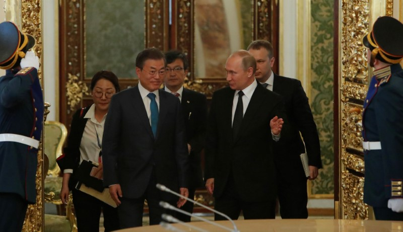 Russian President Putin and South Korean President Moon enter a hall prior to the talks in Moscow