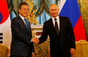 Russian President Putin and South Korean President Moon shake hands during a meeting in Moscow