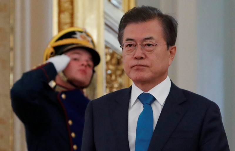 South Korean President Moon enters a hall before a meeting with Russian President Putin in Moscow