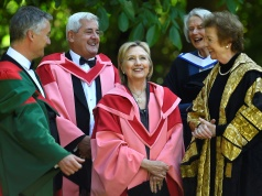 Former US Secretary of State Hillary Clinton laughs with University Chancellor and Former President of Ireland Mary Robinson before being recognised with an honorary degree of Doctor of Laws at Trinity College Dublin