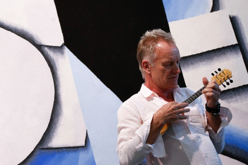 British singer Sting strums a ''baglama'', a traditional Greek instrument during an event organized by Amnesty International and the Athens International Airport in Athens