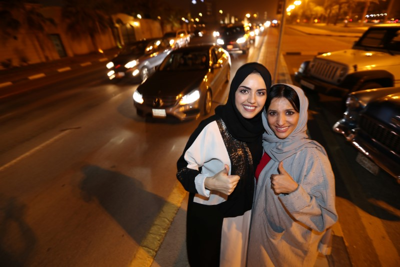 Saudi women celebrate after they drove their cars in Al Khobar
