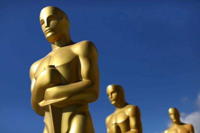 Oscar statues dry in the sunlight after receiving a fresh coat of gold paint as preparations begin for the 89th Academy Awards in Hollywood